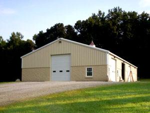 Photo of a RHINO steel barn with brick trim.