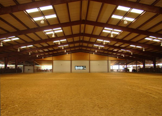 photo of the interior of a steel horseback riding arena