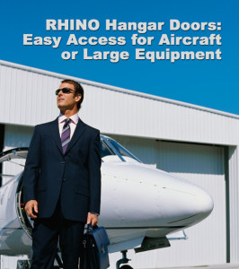 """Businessman stands before a private jet and a steel aircraft hangar with the heading: """"RHINO Hangar Doors."""""""