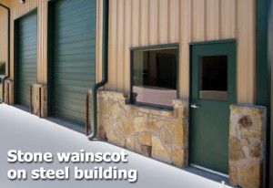 Tan and green metal building with native stone wainscot trim