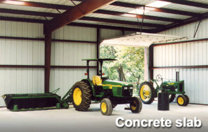 Interior of tractors in a metal building farm structure on a concrete slab