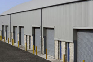 Photo of the receiving doors of a steel warehouse with stone trim.