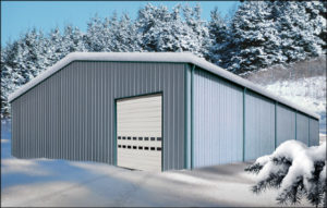 Image of a snow-covered metal building in winter.