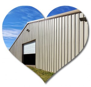 Heart-shaped photo of a large tan metal building