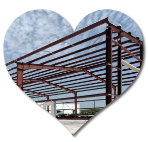 Heart-shaped photo of a metal building under construction