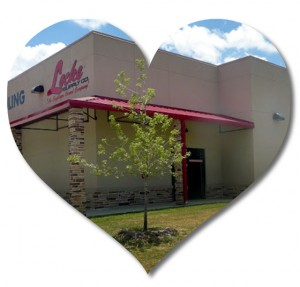 Heart-shaped photo of a stucco-clad steel building used as a plumbing and electrical store