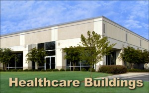 """Photo of a single-story office building with a stucco exteriors and the caption """"Healthcare Buildings"""""""