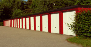 A row of red and brown self-storage units.