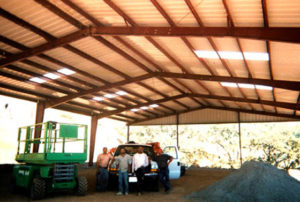 Photo of an open-sided RHINO farm shelter.