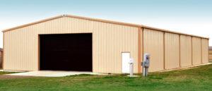 Photo of a large beige RHINO metal barn with tan trim.