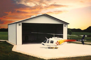 Photo of a RHINO steel hangar with a helicopter.