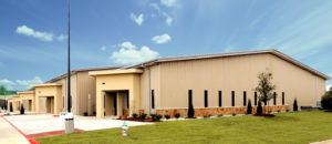 Photo of a line of upscale RHINO warehouses with stone trim.