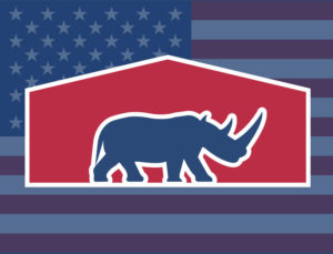 Iconic image of a RHINO inside a steel building against an American flag background.