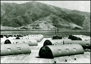 Older photograph of military base Quonset hut quarters