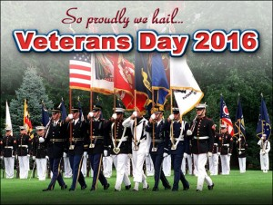 """Color guard of uniformed servicemen marches across green field with """"Veteran's Day 20116"""" headline"""