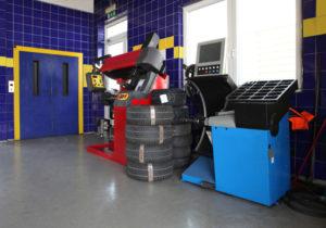 Photo of the interior of a modern car repair shop.