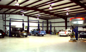 Photo of the open interior of a RHINO car repair building.