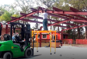 Images shows a man erecting his own RHINO steel building.