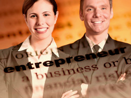 Image of smiling business people with the definition of entrepreneur superimposed over it.