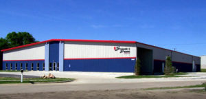 Photo of a RHINO red, white, and blue industrial metal building.