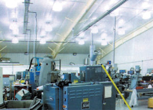 Photo of the interior of an industrial steel building full of large machinery.