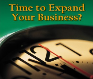 """Close-up of a ticking clock with the question """"Time to Expand Your Business?"""""""