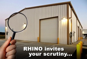 Magnifying glass over attracting tan and brown industrial metal building