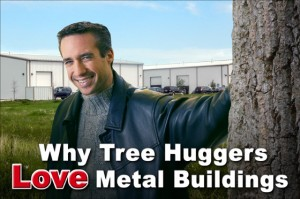 Smiling man in black jacket leans against tree trunk with two white metal buildings in the background