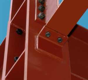 Close-up of steel framing pieces bolted together.