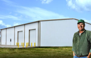 Photo of a large RHINO metal building with two bay doors and a personnel door.