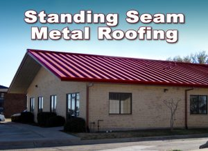 Steel office building with sandy-colored brick and red standing seam metal roof.