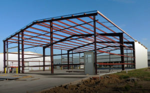 Photo of a RHINO pre-engineered metal building under construction.