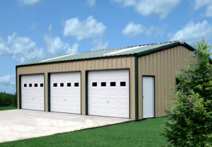 Photo of a green and tan 3-car metal garage.