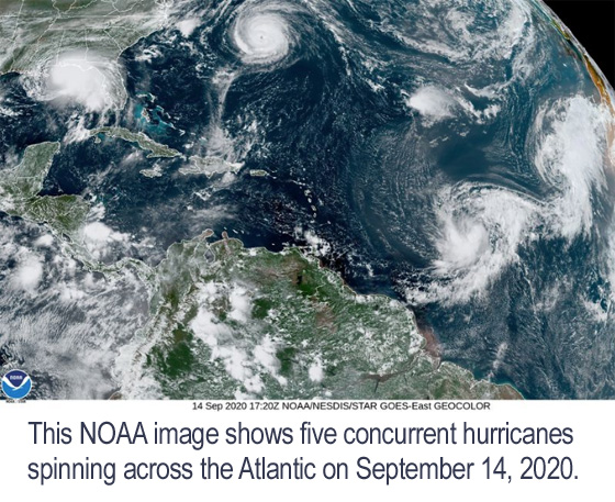 Satellite photo of five simultaneous hurricanes appearing across the Atlantic.