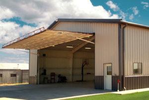 Photo of one of RHINO's airplane hangar kits with the hangar door open.
