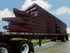 Close up of a RHINO metal building kit loaded on a truck for shipping.