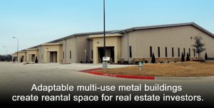Large warehouse-type structure in an industrial park. Tan stucco with stone trim.