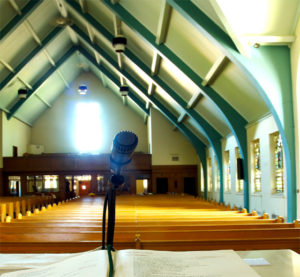 Photo of interior of a steel-framed church sanctuary.
