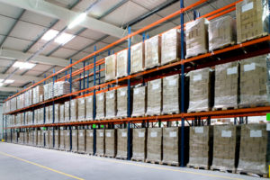 Photo of huge racks stocked with products as used in steel warehouses and distribution centers.