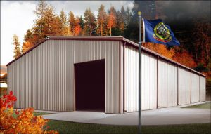 white and brown metal building in Idaho near forest with state flag flying