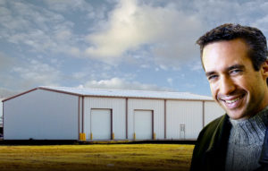 Smiling man with a 40 x 60 metal building behind him.
