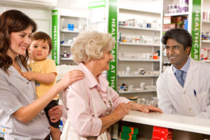 Three generations pictures at the pharmacy counter.