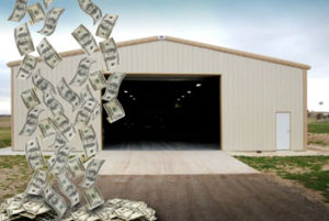 Photo of a RHINO metal building with a shower of money falling in front of it to indicate savings.
