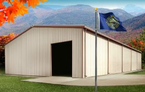 a tan steel building in New Hampshire in autumn, with the state flag flying in front of it