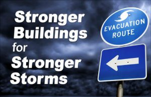 dark, stormy sky with a hurricane evacuation route sign with the text Stronger Buildings for Stronger Storms