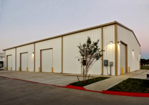 Photo of a 3-bay RHINO pre-engineered building at dusk.