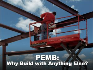 a man on a scaffold attaching a steel roof rafter on a PEMB- a pre-engineered metal building