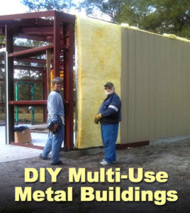 two men applying insulation to a multi-use steel building