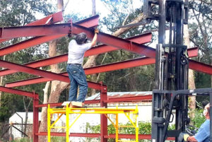 Photo of a man and his father erecting their own RHINO metal building.