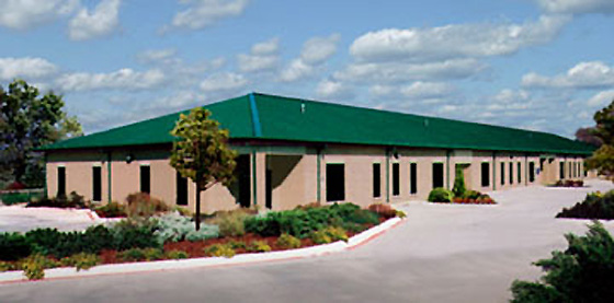 Photo of a RHINO commercial building with a Green hip roof.